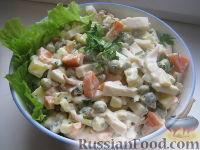 Фото к рецепту: Салат из кальмаров с картофелем и морковью