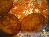 Фото к рецепту: Котлеты из кильки в томате.