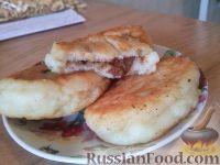 Фото к рецепту: Сырники с шоколадной начинкой