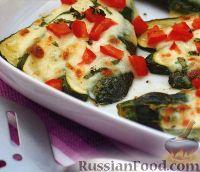 Фото к рецепту: Цуккини, запеченные с сыром и помидорами