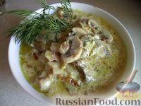 Фото к рецепту: Жареные шампиньоны со сметаной