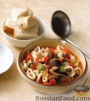 Фото к рецепту: Рагу из морепродуктов в томатном соусе