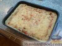 Фото к рецепту: Картофельная запеканка с куриной начинкой