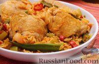 Фото к рецепту: Куриные бедрышки с рисом и овощами