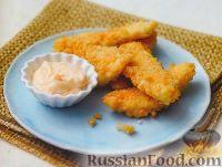 Фото к рецепту: Рыбные палочки с острым соусом