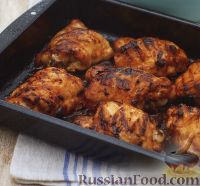 Фото к рецепту: Куриные бедрышки, жаренные с соусом барбекю