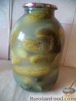 Фото приготовления рецепта: Засолка огурцов в банках - шаг №11