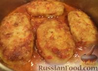 Фото к рецепту: Рыбные котлеты под томатным соусом