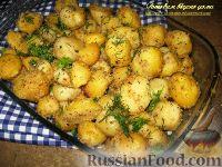 Фото к рецепту: Картофель, запеченный с чесноком в сухарях