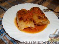 Фото к рецепту: Голубцы с мясом и рисом