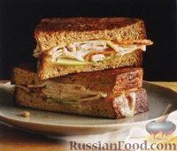 Фото к рецепту: Бутерброды с индюшиной ветчиной и сыром