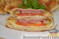 Фото к рецепту: Жареный в яйце лаваш с начинкой