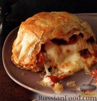 Фото к рецепту: Сыр буратта, запеченный в тесте