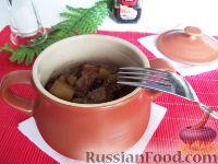 Фото к рецепту: Свинина в горшочках
