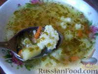 Фото к рецепту: Куриный суп с манными галушками