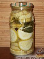 Фото к рецепту: Маринованные кружки кабачков