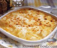 Фото к рецепту: Пикша, запеченная в сырном соусе