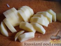 Фото приготовления рецепта: Скумбрия, запеченная с овощами - шаг №4