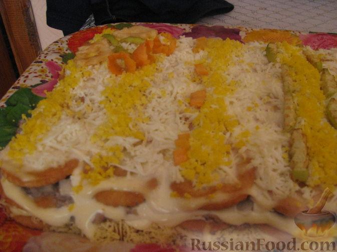 Рецепт Закусочный тортик с крекерами.