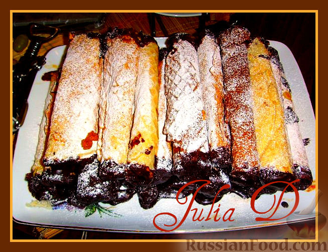 Рецепт Вафельные трубочки с вареной сгущенкой в шоколадной глазури