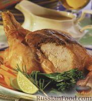 Фото к рецепту: Жареная курица, фаршированная орехами