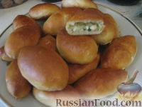 Фото к рецепту: Пирожки с яйцом, рисом и зелёным луком