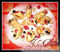 Фото к рецепту: Сладкие роллы с ягодами