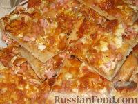 Фото к рецепту: Пицца с вареной колбасой, яйцом и сыром