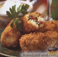 Фото к рецепту: Куриные котлеты с ветчиной