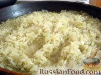 Фото к рецепту: Рис тушеный с луком и специями