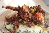 Фото к рецепту: Рагу из кролика с грибами и белым вином