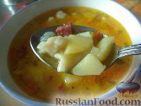 Фото к рецепту: Суп с галушками и копченой колбасой