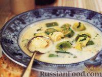 Фото к рецепту: Молочный суп с пореем и овсянкой
