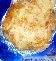 Фото к рецепту: Тилапия под овощной шубой