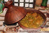 Фото к рецепту: Тажин из курицы с оливками и солеными лимонами