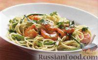 Фото к рецепту: Спагетти с креветками и зеленым горошком