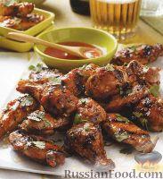 Фото к рецепту: Куриные крылышки, жаренные в остром соусе на гриле