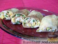 Фото к рецепту: Блинчики, фаршированные яйцом и луком