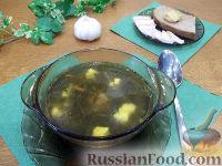 Фото к рецепту: Борщ из замороженного щавеля, с яйцом