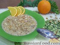 Фото к рецепту: Овсяная каша с апельсином и арахисом