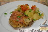 Фото к рецепту: Запеченная курица с картошкой