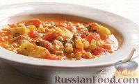 Фото к рецепту: Томатное рагу с рыбой и кукурузой