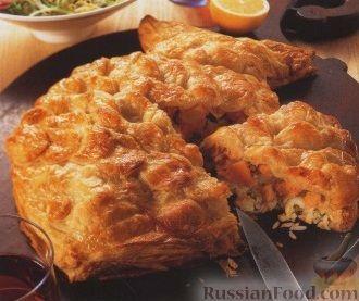 Рыбный пирог из слоеного теста с консервой и рисом пошагово с