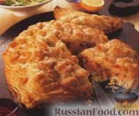 Фото к рецепту: Рыбный пирог из слоеного теста (в виде рыбы)