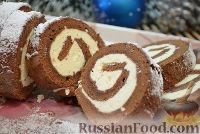 Фото к рецепту: Шоколадный рулет со сливочным кремом