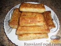 Фото к рецепту: Блинчики с начинкой из яиц и лука