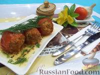 Фото к рецепту: Тушеные помидоры, фаршированные мясом и рисом