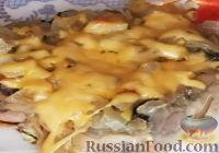 Фото к рецепту: Пельмени, запеченные в духовке