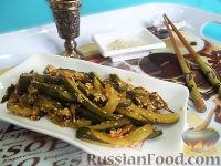 Фото к рецепту: Салат из жареных огурцов по-корейски
