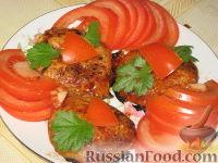 Фото к рецепту: Свиные отбивные, запеченные под ананасами и сыром